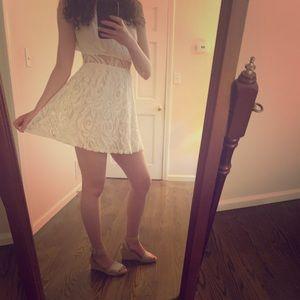 White lace dress with waist cutout